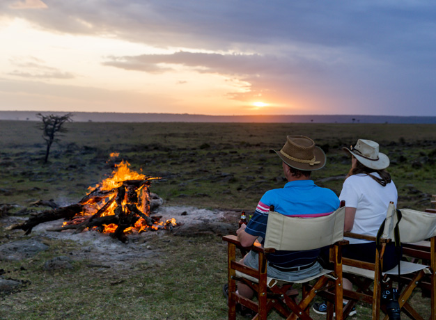 Watch the sun set over the stunning Kenyan landscape with a cool refreshing drink