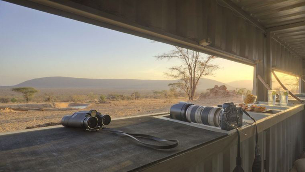 5. Bunker down in a hide to take photos on safari